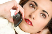 Beautiful young woman calling by mobile phone — Stock Photo