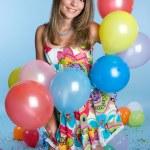 Girl Holding Balloons — Stock Photo #11384793