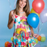 Girl Holding Balloons — Stock Photo #11384802