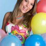 Girl Holding Balloons — Stock Photo #11384829