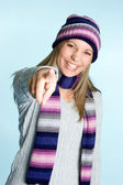 Winter woman showing thumb — Stock Photo