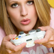 Teenage girl playing computer games — Stock Photo