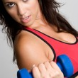 Woman Lifting Dumbbells — Stock Photo #11551057