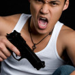 Man with a gun - Stock Photo