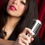 Beautiful girl with microphone — Stock Photo