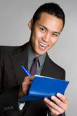 Young businessman with a notebook — Stock Photo