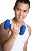 Young man with dumbells — Stok fotoğraf