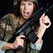 Stock Photo: Female Soldier with automatic Gun