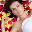 Woman Laying in Rose Petals — Stock Photo