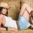 Stock Photo: Cute Cowgirl Laying Down