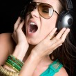 Stock Photo: Singing Woman Wearing Headphones
