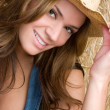 Stock Photo: Smiling Cowgirl