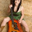 Stock Photo: Woman with Guitar