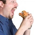 man essen burger — Stockfoto