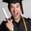 Excited Graduating Boy - Stock Photo