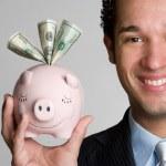 Man Holding Piggy Bank — Stock Photo #11754716