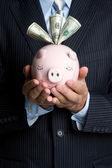 Businessman Holding Piggy Bank — Stock Photo