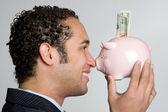 Piggy bank man — Stockfoto