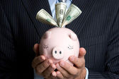 Businessman Holding Piggy Bank — Stock Photo