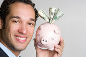Man Holding Piggy Bank — Foto Stock