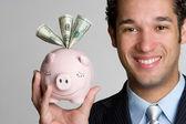 Man Holding Piggy Bank — Stock Photo