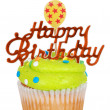 Green birthday cupcake with balloon candle — Stock Photo