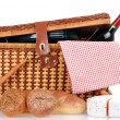Picnic basket with bread cheese and wine — Stock Photo