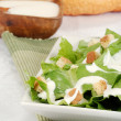 Cesar salad on green napkin - Stock Photo