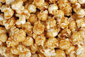 Caramel candy popcorn background — Stock Photo