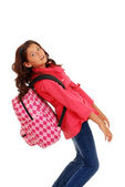Young school girl with heavy backpack — Stock Photo