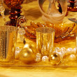 Gold christmas table decorations — Stock Photo