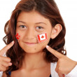 Young girl with Canada day stickers on face — Stock Photo