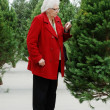 Senior shopping for christmas tree — Stock Photo #11898230
