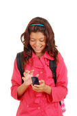 Laughing young girl with cell phone — Stock Photo