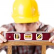 Worker using level — Stock Photo #12397351