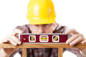 Worker using level — Stock Photo