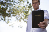 Man Holds Bible — Stock Photo