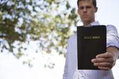 Man Holds Bible — Stock Photo