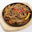 Buckwheat noodles with beef — Stock Photo
