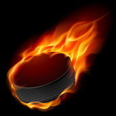 Burning hockey puck — Stock Vector
