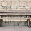 Bench against wall, loneliness and absence — Stock Photo #11836682