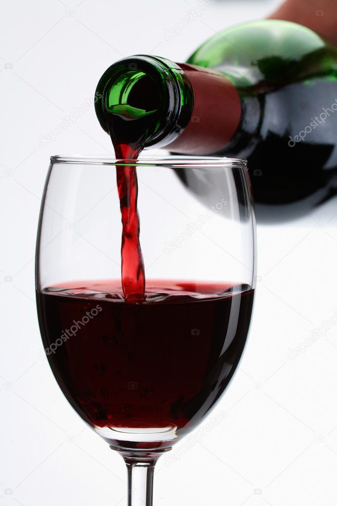 Red wine pour in a glass on white background — Stock Photo #11310314