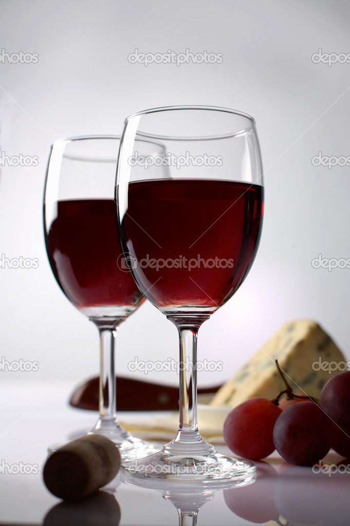 Red wine, grape  and cheese in the background  Stock Photo #11311164