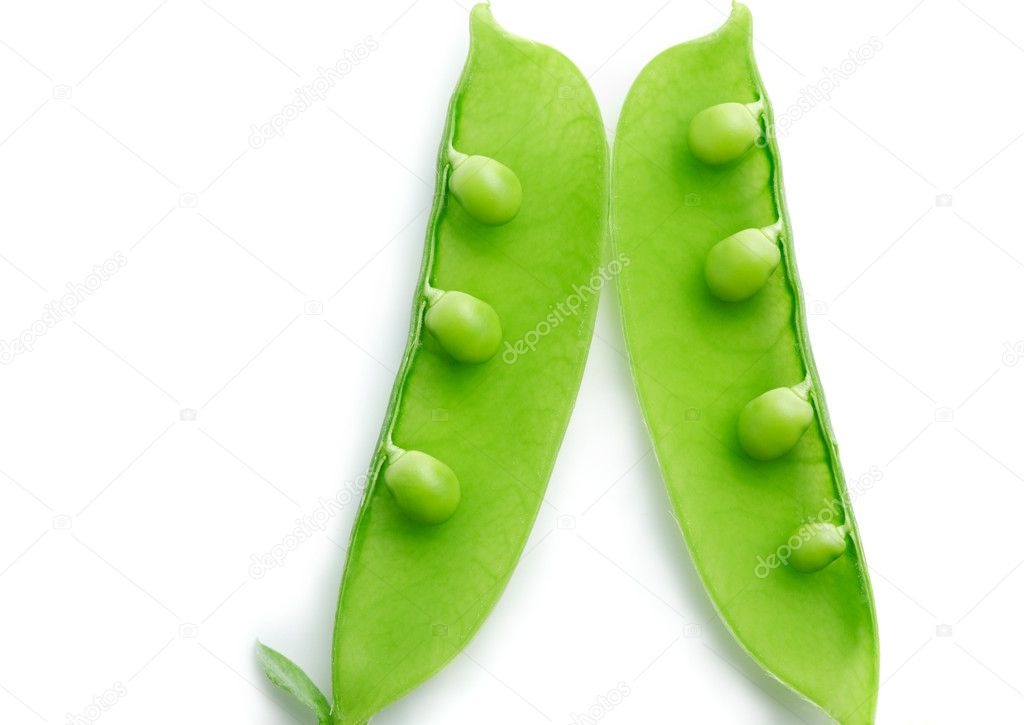 A close-up of a pea pod split open revealing peas on white background — Стоковая фотография #11311395