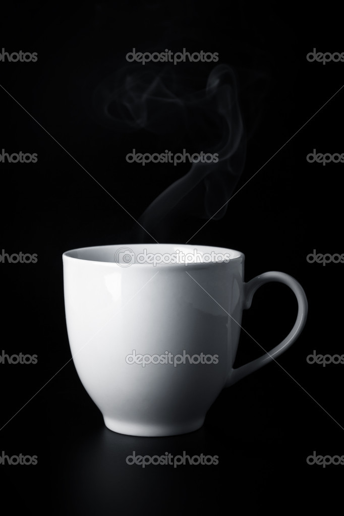 White cup with hot liquid and steam on black  Stock Photo #11250409