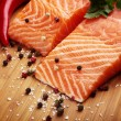 Salmon with lemon and pepper — Stock Photo #12251669