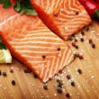 Salmon with lemon and pepper — Stock Photo #12251675
