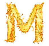 Orange liquid splash alphabet — Stock Photo
