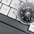Computer keyboard and retro compass, business decision — Stok fotoğraf