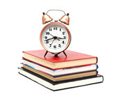 Clock and books on a white background — Foto Stock